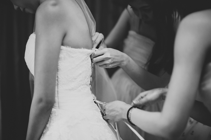 putting on the wedding gown
