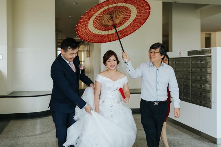 bride under the red umbrella