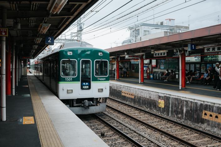 train at fushimi inari station kyoto
